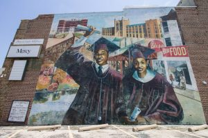 "Mural ""Ode To West Philly"" by Ras Malik was added to the west-facing party wall in 1997 