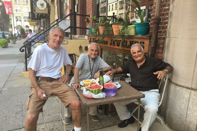 """On Jewelers Row, (from left) jewelry designer Jean Huffenus and merchants John Khodandian and Reuven Cohen share a lunch on the sidewalk in front of their Sansom Street shops."" 