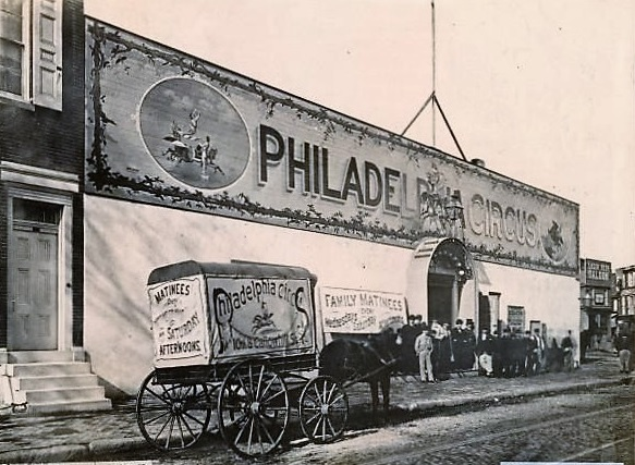 The original Philadelphia Circus building at 10th and Callowhill, in 1870, with a wagon advertising the circus in front on 10th Street| image found at www.freelibrary.org