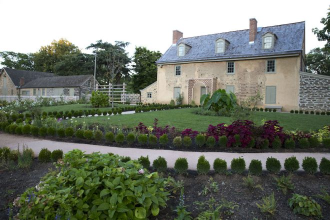 The newly restored and highly manicured Ann Bartram Carr garden on the north side of the Bartram house illustrates the site's 19th century history with exotic plants in symmetrical arrangements.   Photo: Starr