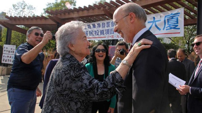 """Gov. Tom Wolf greets Cecelia Yep, who led Chinatown's fight against the Vine Street Expressway in 1966. Wolf announced a $1.3 million state grant to help build a community center that would help bridge the gulf created by the expressway."" 