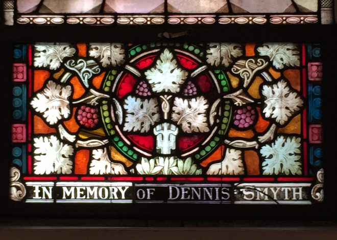 Although Smyth requested a modest grave marker in his will, parishioners at Our Mother of Sorrows memorialized his generosity and deep involvement in the church with this stained glass panel. | Photo: Joshua Bevan